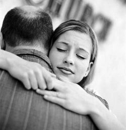 Daughter_hugging_father_1822957